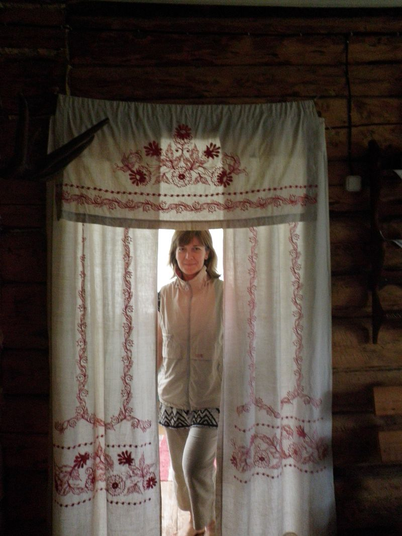 Olga in linen decorated doorway