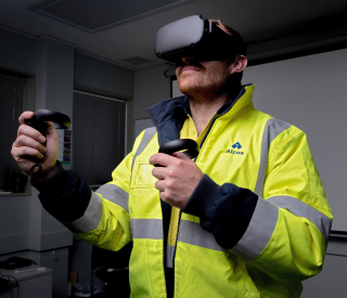 Alcoa Operator Ben Curtis tests out the arc flash isolation simulation at Pinjarra Refinery